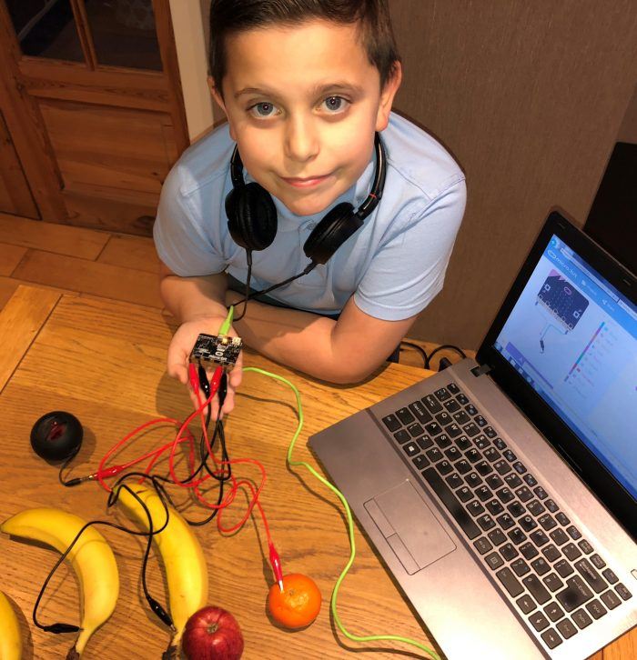 Ten year old Matthew with his microbit jukebox controlled by fruit